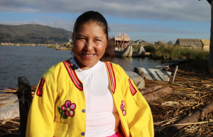 Dora Jallahui Vilca describes her favorite parts of life on the Uros Islands. (Photograph by Donovan C Baltich)