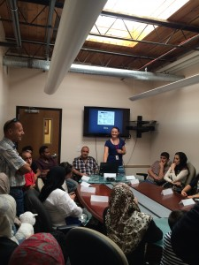 A Catholic Community Services volunteer, center right, leads a cultural orientation class with a group of newly arrived refugees. (Danielle Stamos)