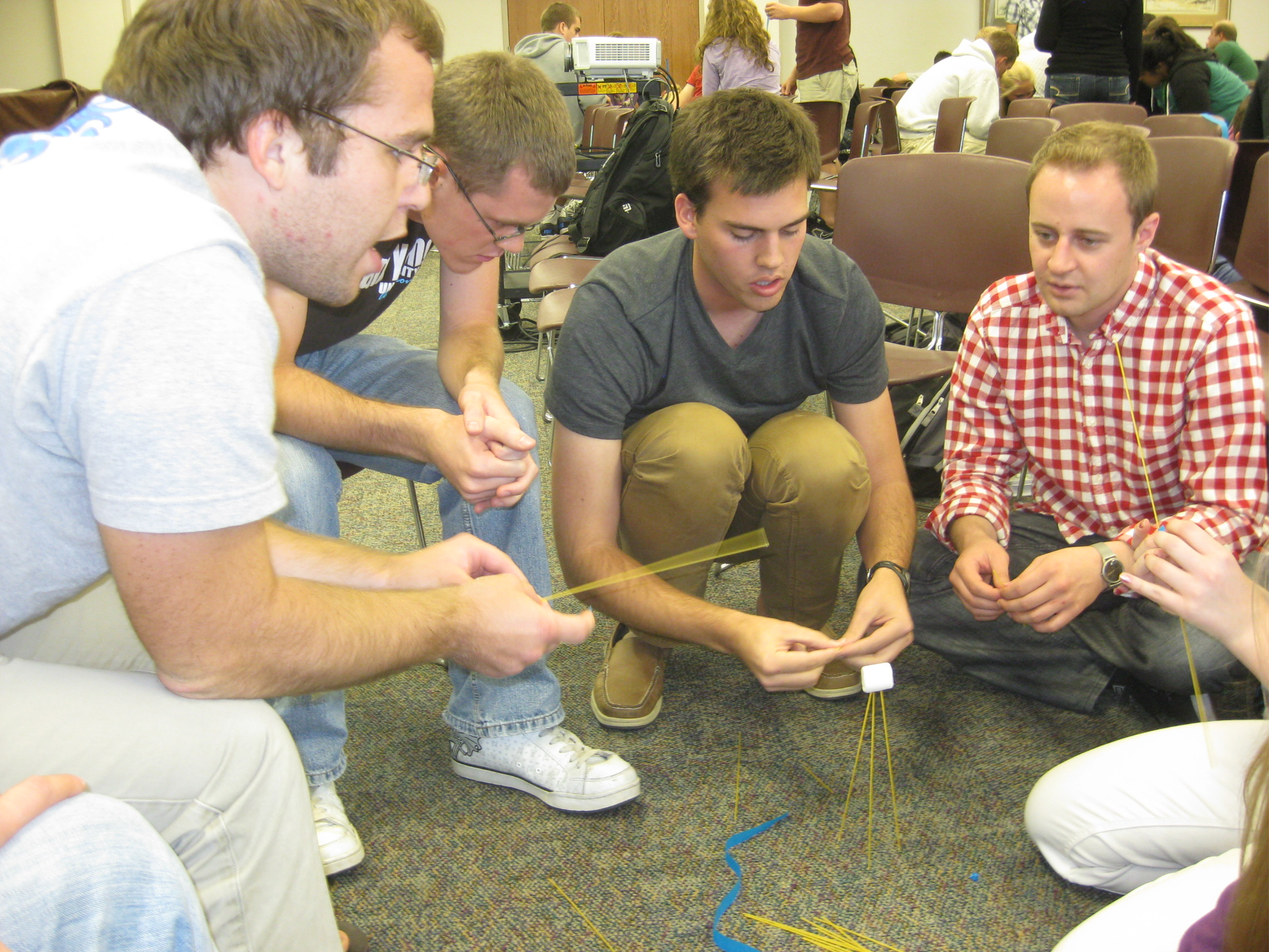 Students practice innovative skills by building structures using only spaghetti, a marshmallow and tape.
