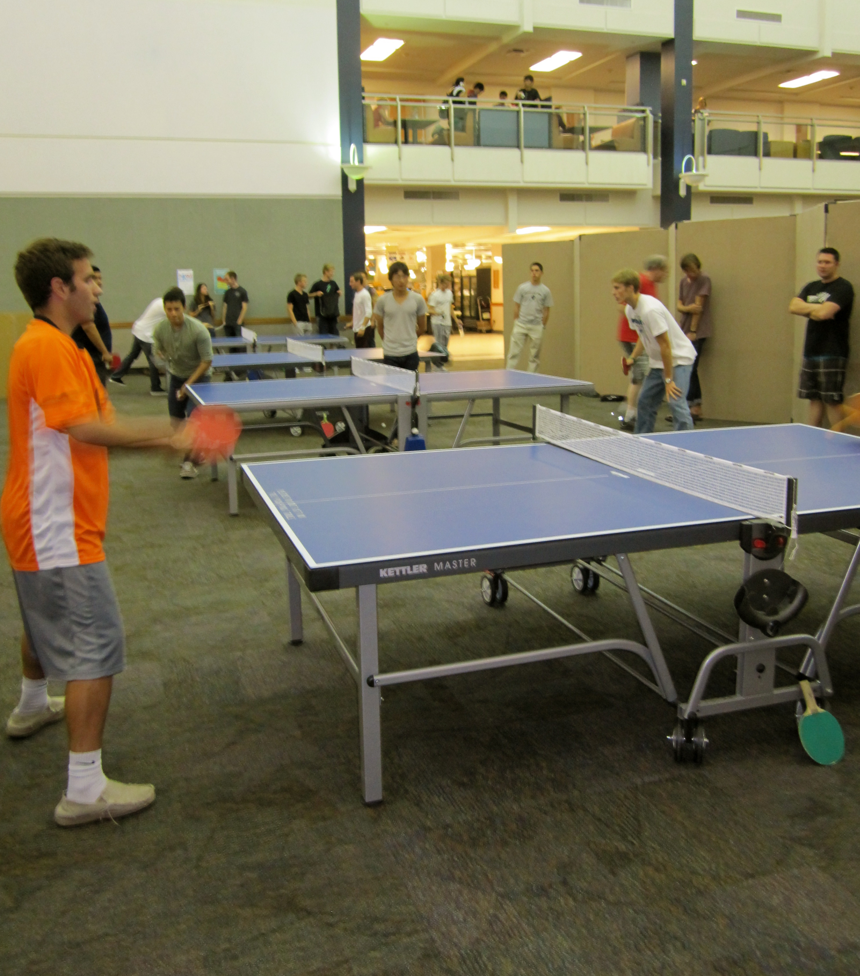 Members of the ping pong club practicing what they love on a Tuesday night.