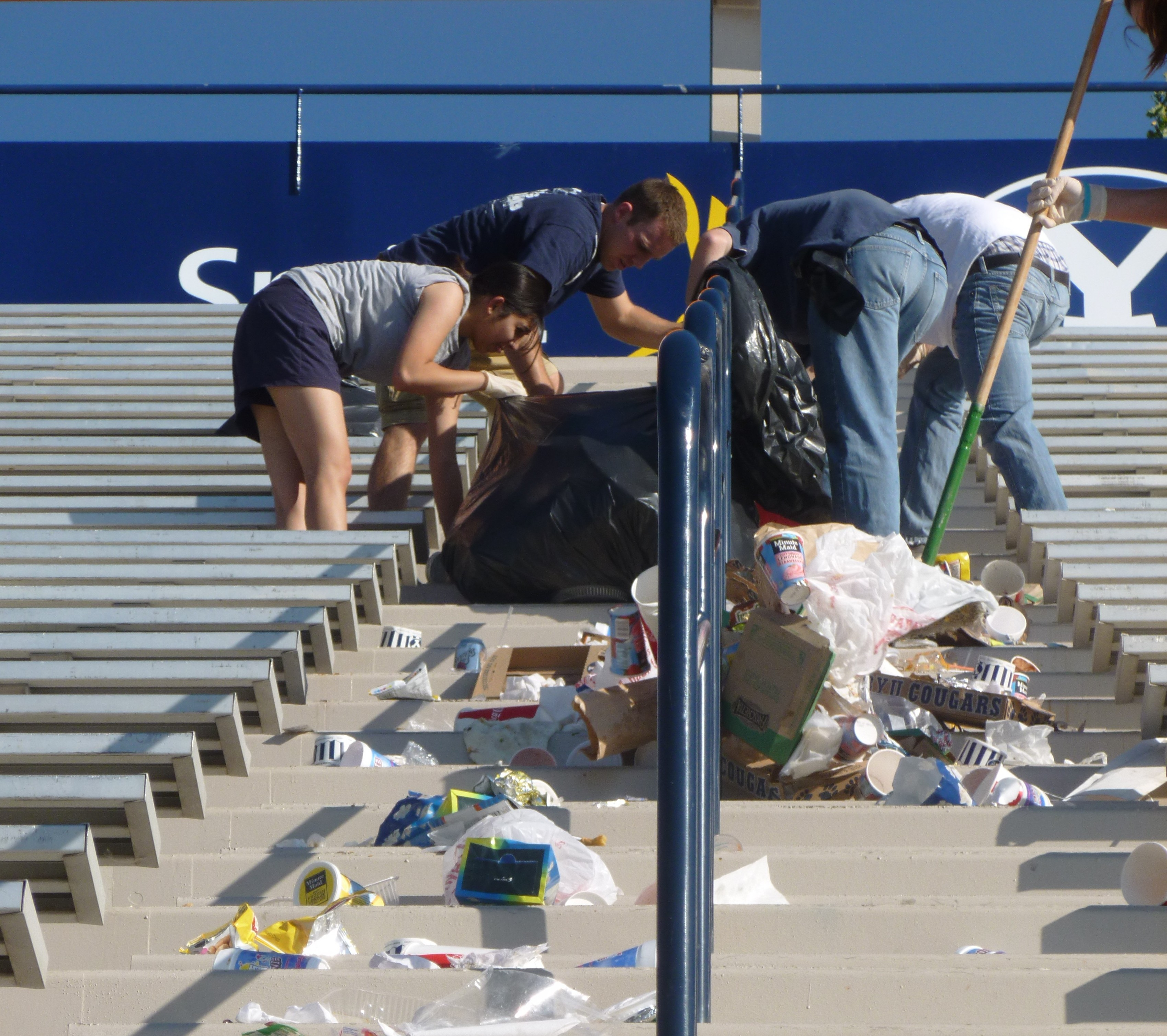 Cadets bag all the trash swept into ailes.