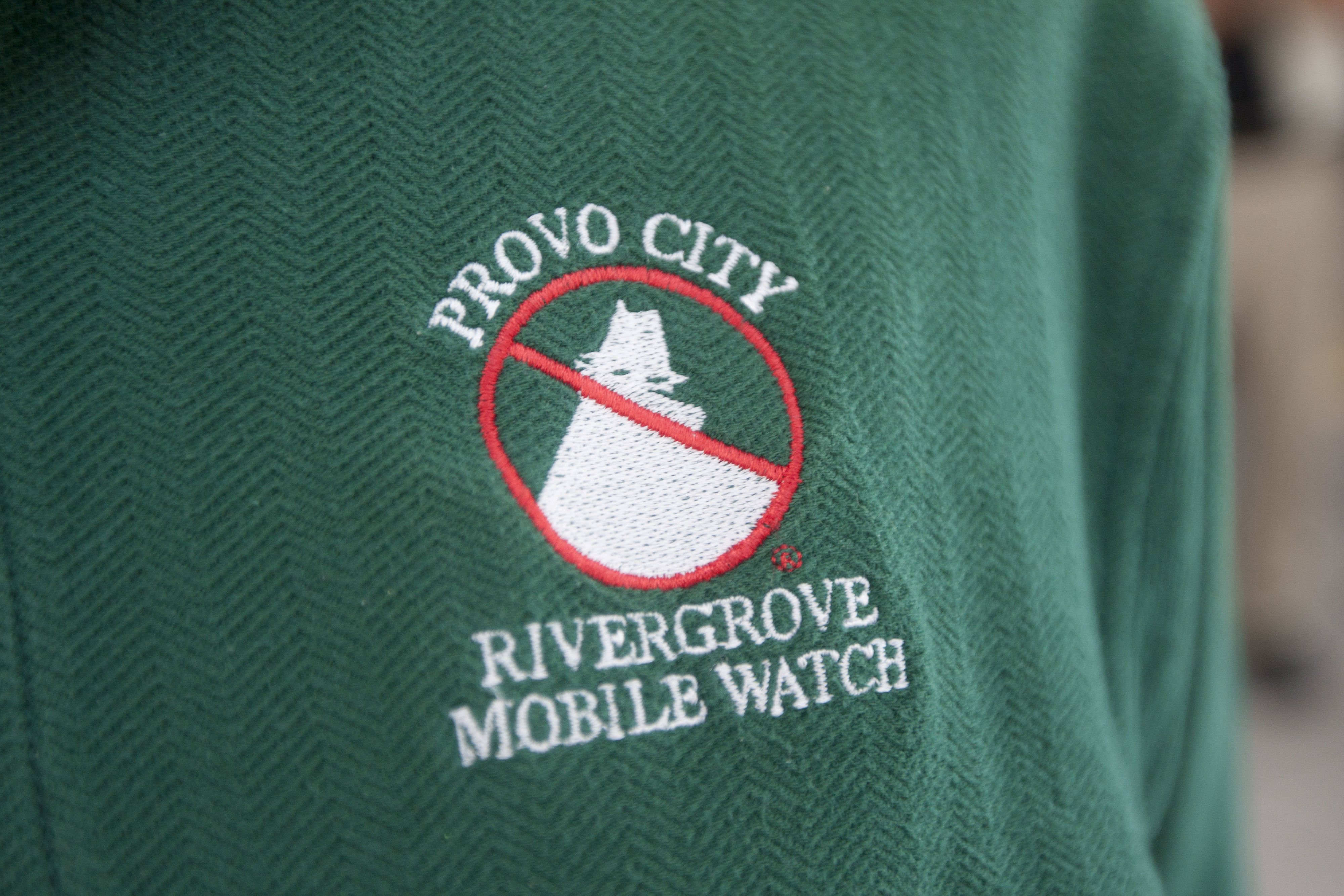 A Provo Police volunteer wears his Mobile Watch shirt. photo by Chris Bunker