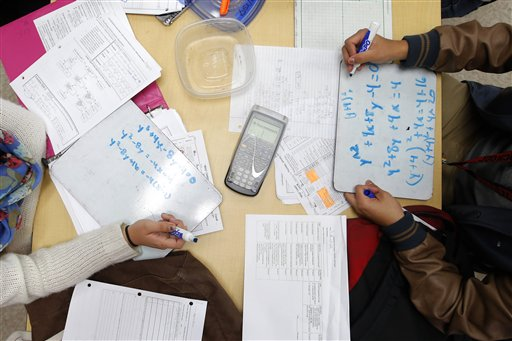 Public and private schools differ in methods of individualized learning for each student and average class size. (AP Photo)