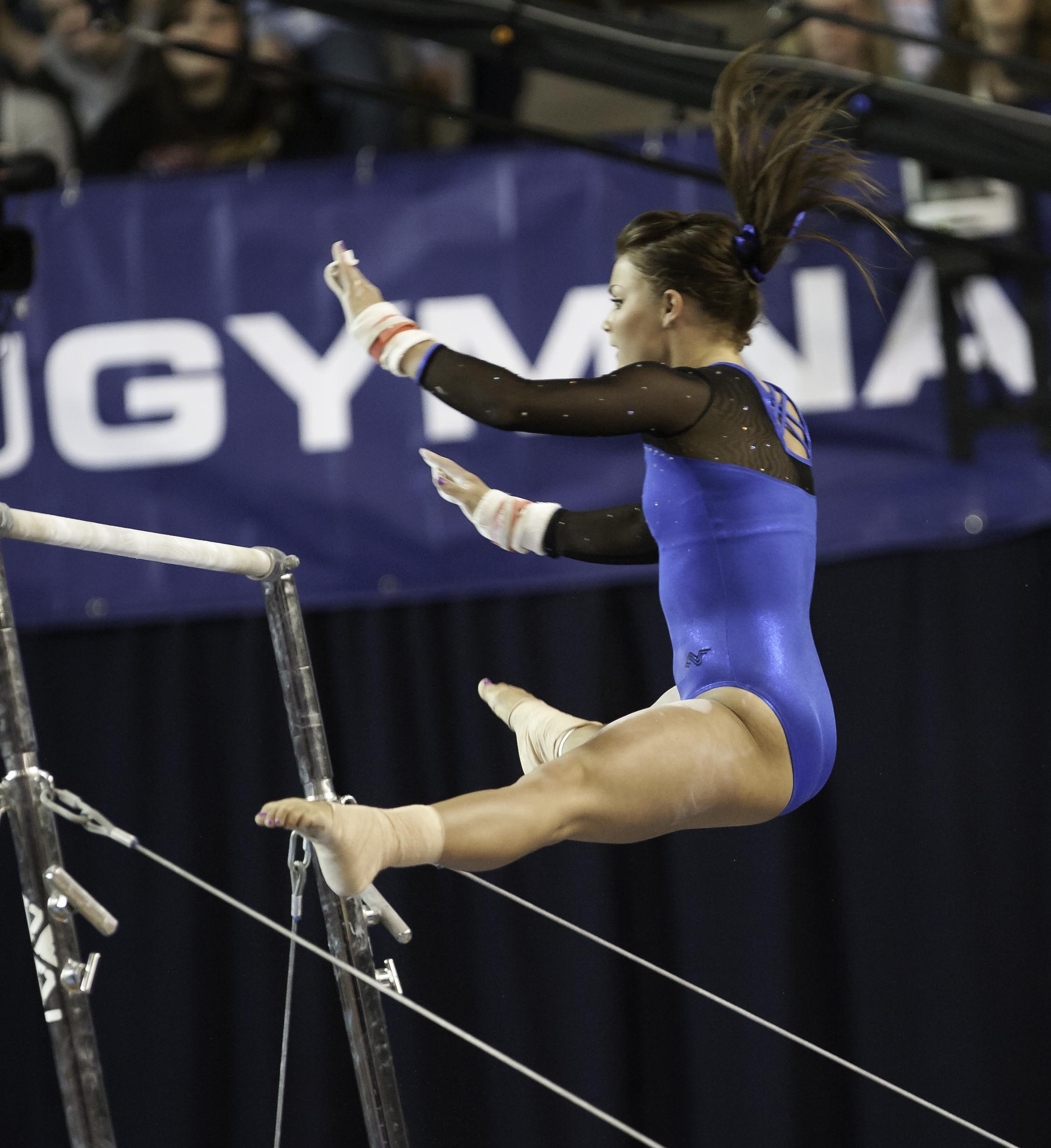 Sarah Yandow Wensel on the bars in BYU's gymnastics meet against Biose State on Saturday. (Photo by Elliott Miller)