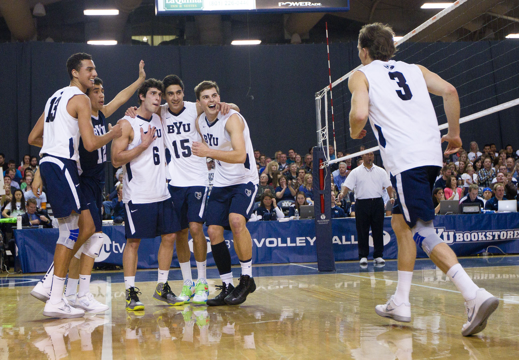 The team celebrates a point against UC Irvine on Friday night.