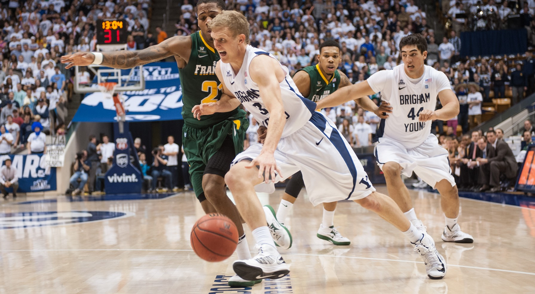 Tyler Haws dribbles by San Francisco defender De'End Parker during last year's game in the Marriott Center. Photo by Chris Bunker.