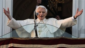 Pope Benedict XVI greets the crowd from the window of the Pope's summer residence of Castel Gandolfo (AP photo)