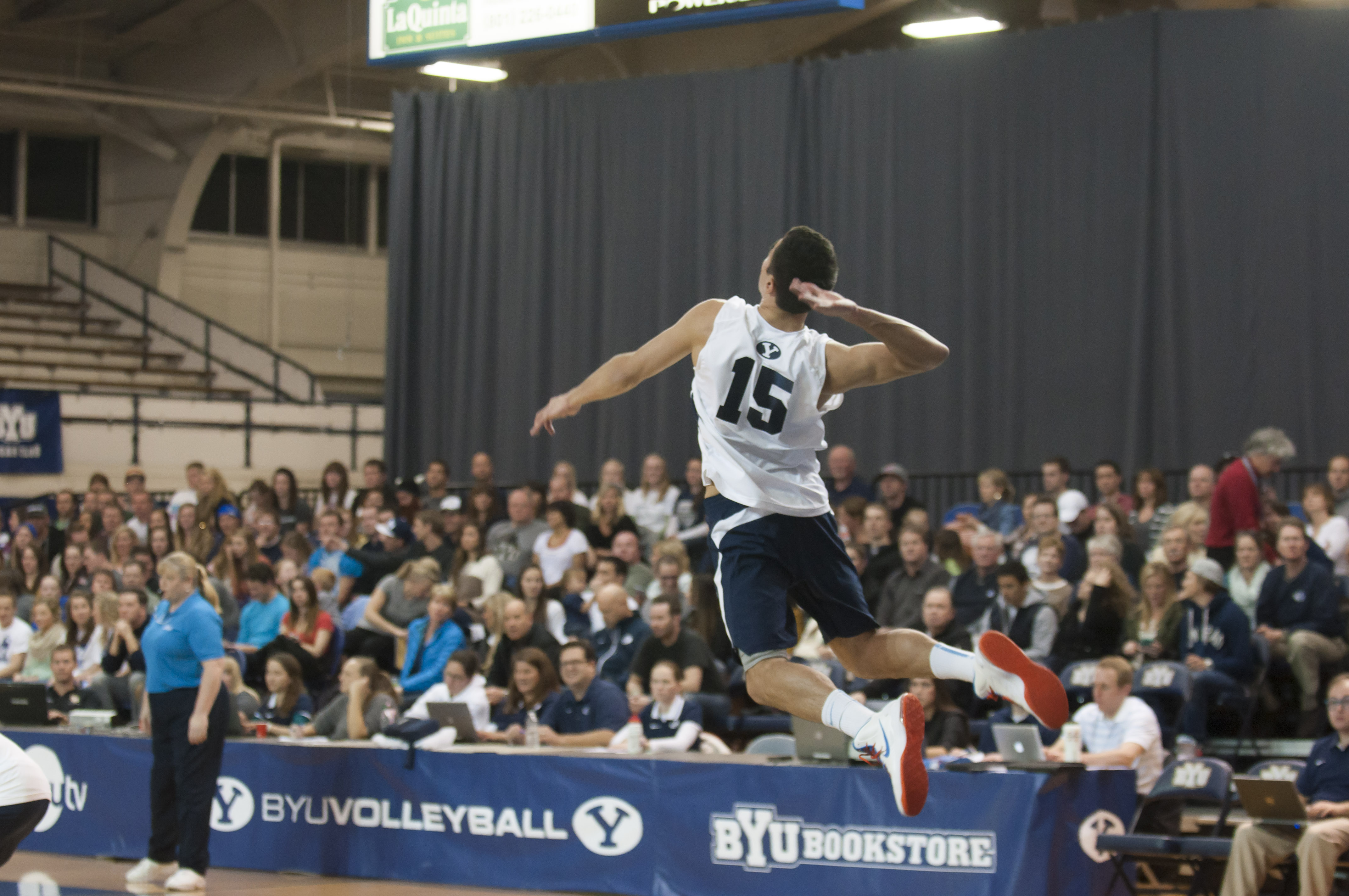 BYU's Taylor Sander serves it up in a game against Long Beach. Photo by Whitnie Soelberg.