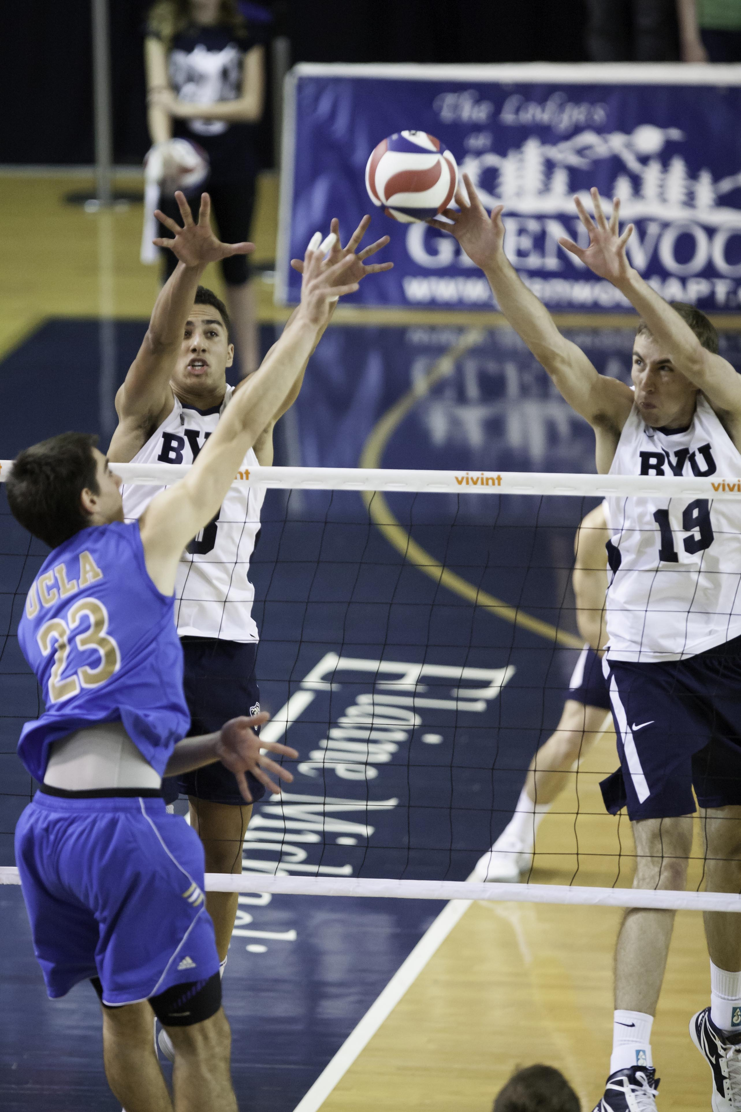 BYU's Ben Patch and Devin Young reach to block UCLA's Gonzalo Quiroga spike in Saturday's home match against UCLA. (Photo by Elliot Miller)