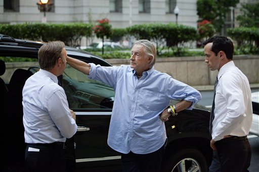 """This image released by Netflix shows Kevin Spacey, left, director Joel Schumacher, center, and Nathan Darrow during the filming of the Netflix original series, """"House of Cards."""" The new original series arrived in one big helping _ all 13 episodes of its first season _ on the subscription streaming service on Friday, Feb. 1, 2013, for viewers to enjoy, at their leisure, in the weeks, months or even years to come. (AP Photo/Netflix, Melinda Sue Gordon)"""