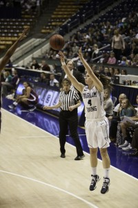 Kim Beeston shoots for three at home against LMU. (Photo by Elliott Miller)