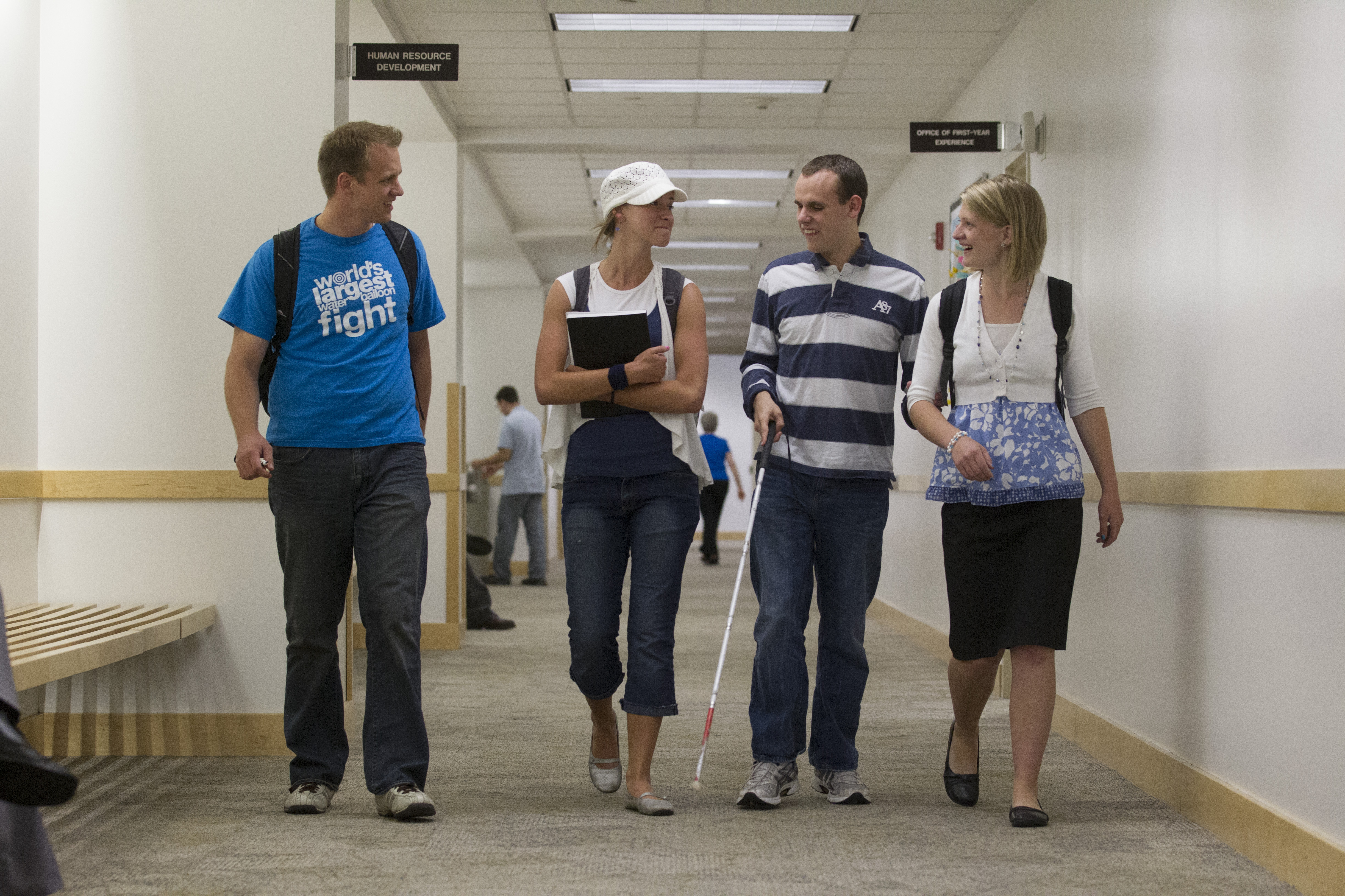 BYU students walk with blind student Kirt Manwaring  (photo by Mark Philbrick)