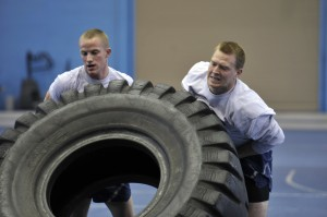 BYU Air Force cadets Jesse Lanham (left) and Dallin Gray (right)  hefting a tire during the obstacle course. (Air Force photo by Staff Sgt. Renae Saylock/Released)