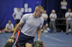 Cadet Jesse Lanham runs with containers full of sand as part of the obstacle course. (Air Force photo by Staff Sgt. Renae Saylock/Released)