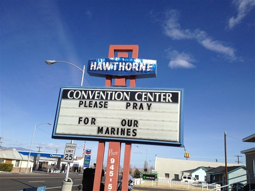 A sign showing support  for the seven U.S. Marines killed in an explosion. (AP Photo)