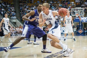 BYU guard Tyler Haws dribbles by Washington defender Scott Suggs during Tuesday's game at the Marriott Center. (Photo by Chris Bunker)
