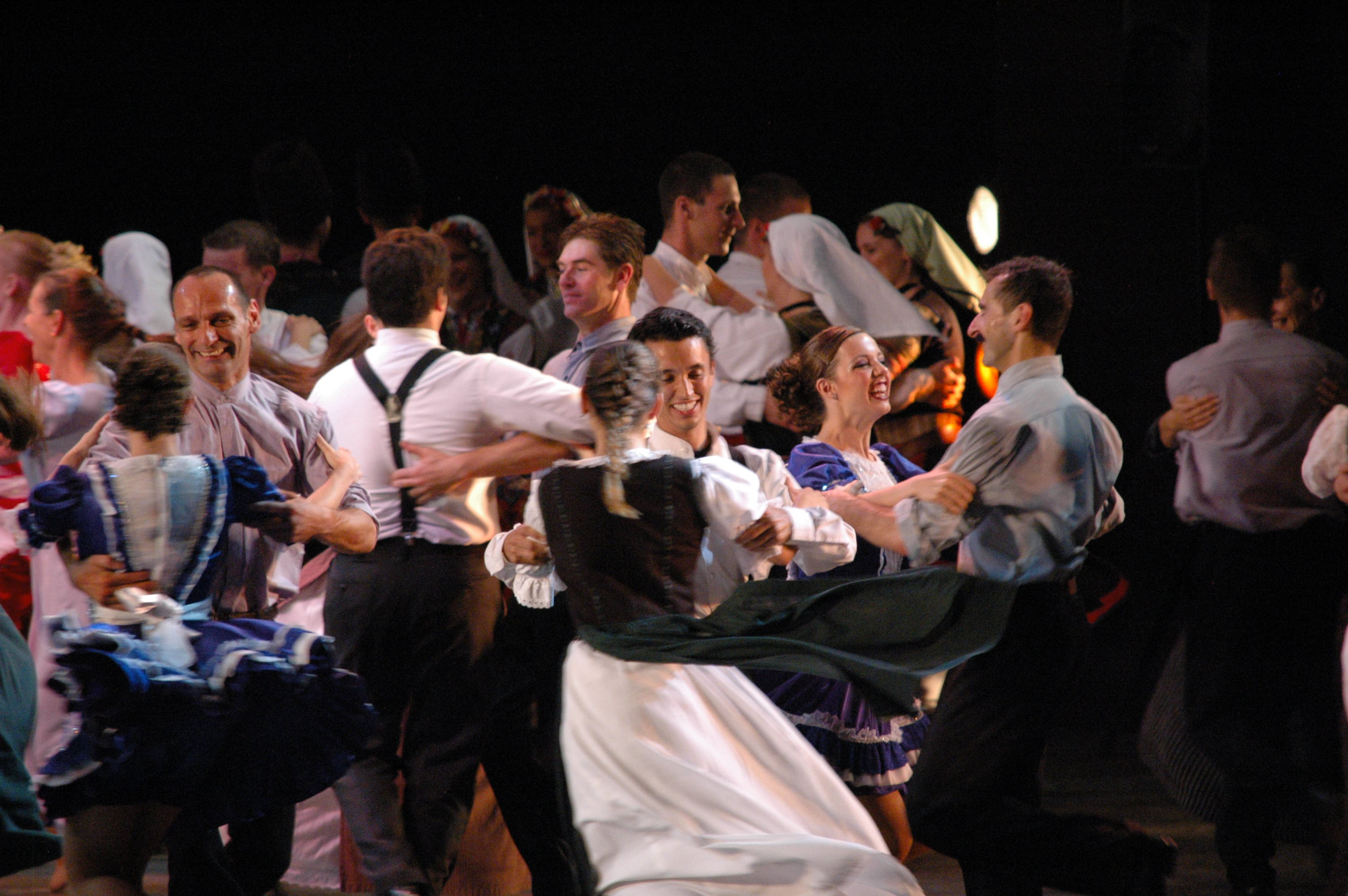 """At a dance festival in Budapest, BYU folk dancers partnered with members of the Hungarian State Folk Ensemble and Duna Art Ensemble to dance the Hungarian """"Szatmári."""" The dancers and other BYU groups demonstrate both their faith and academic achievement abroad. Photo courtesy Jonathon Wood."""