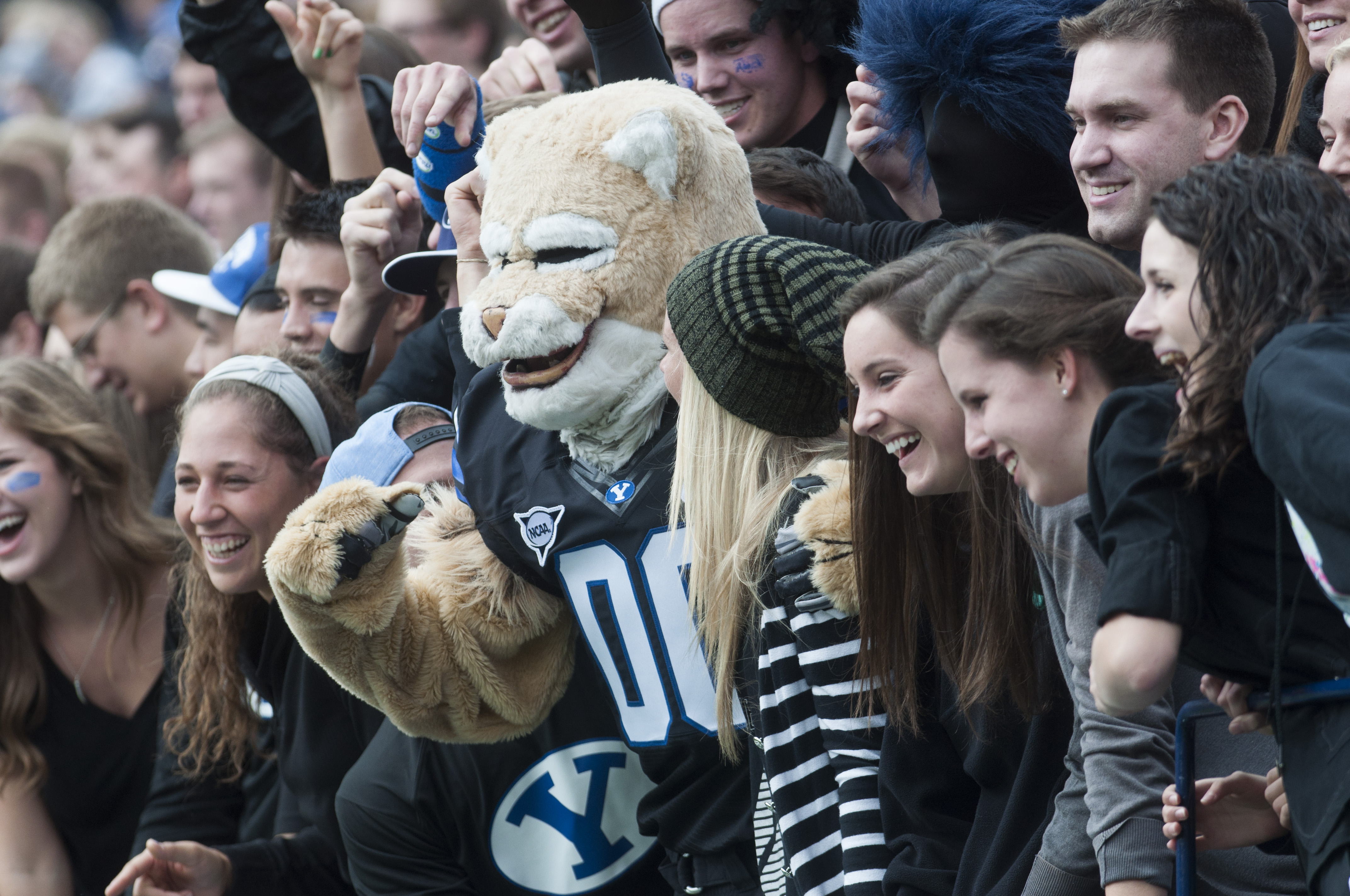 Cosmo poses with fans during the blackout game against Oregon State at LaVell Edwards Stadium in October 2013 (Photo by Universe Photographer)