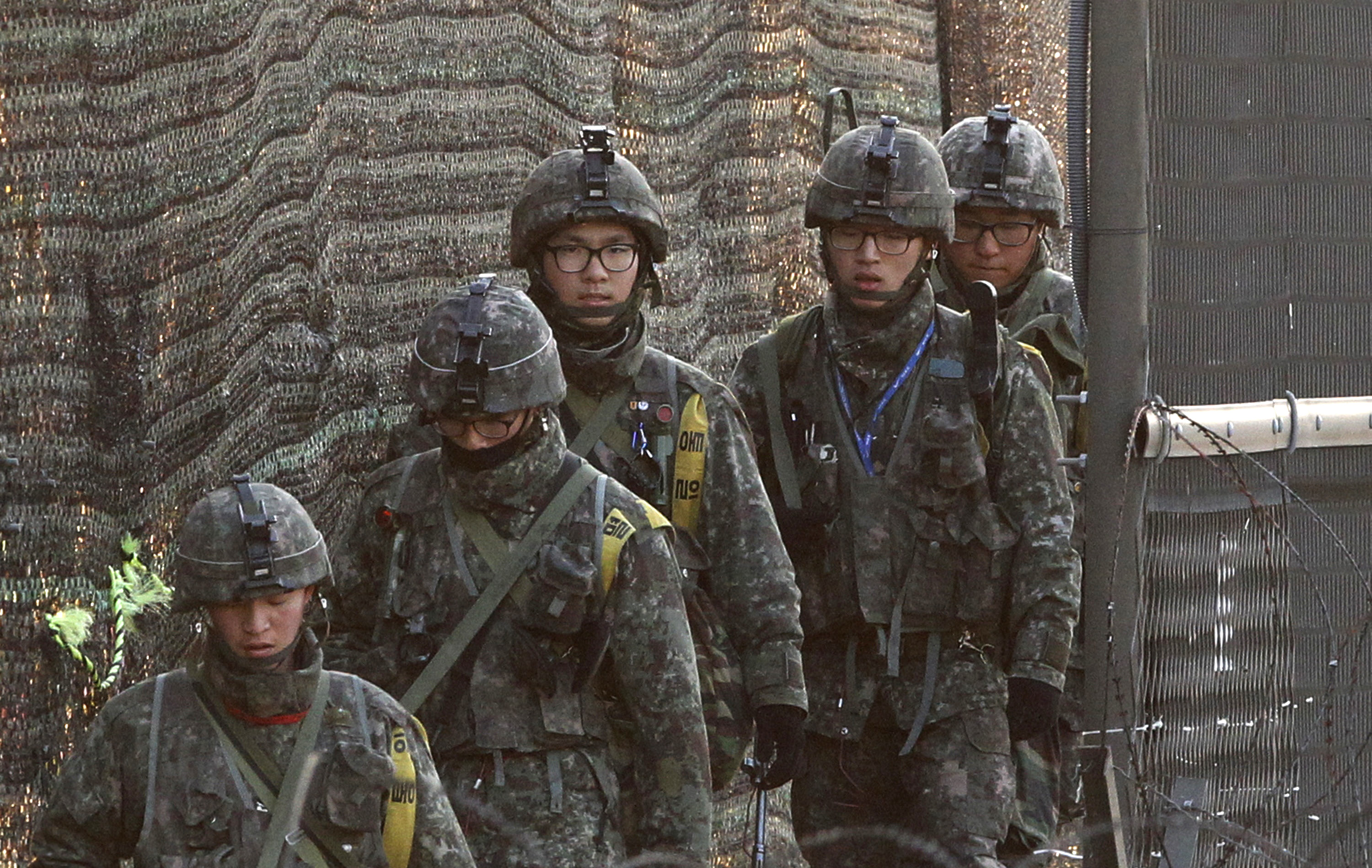 South Korean army soldiers patrol along a barbed-wire fence near the border village of Panmunjom in Paju, South Korea, Wednesday, March 27, 2013. (AP Photo/Ahn Young-joon)