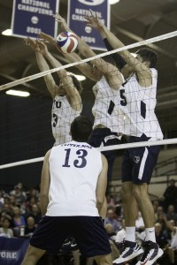 BYU attempts a block against Pepperdine on Thursday night. (Photo by Elliott Miller)