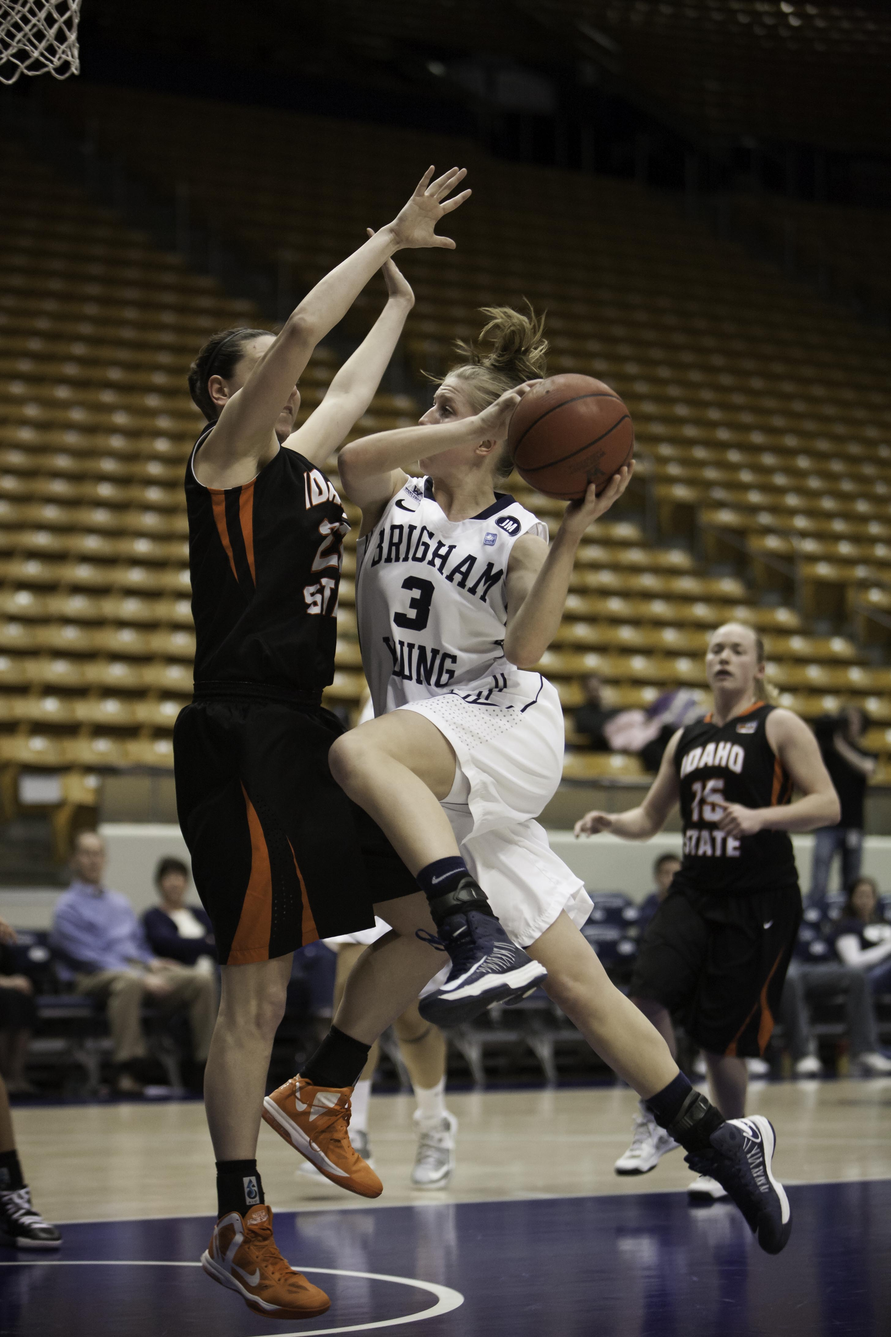 Ashley Garfield jumps for the lay up in Wednesday's WNIT game against Idaho State. (Photo by Elliott Miller)