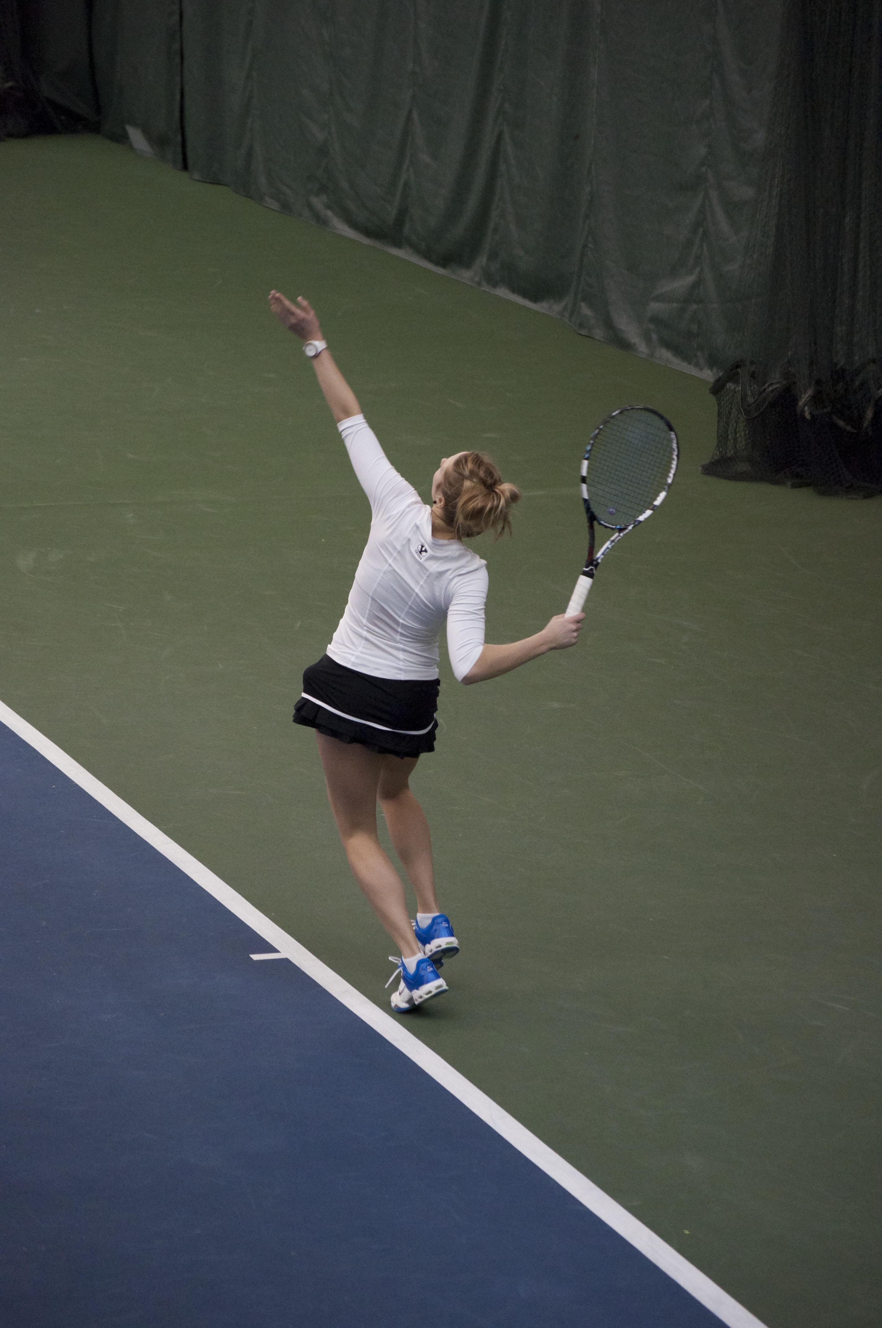 Morgan Anderson serves in her Feb. 8 match. The Cougars take on Gonzaga Saturday. (Photo Sarah Hill)