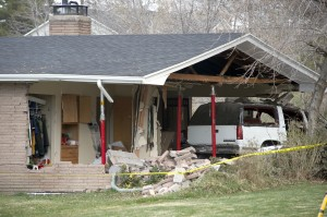 A car crashed through a house just north of the Marriott Center Friday morning. (Photo by Chris Bunker)