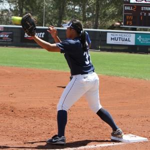 Katie Manuma catches the ball at first base. (Photo courtesy BYU Athletics)
