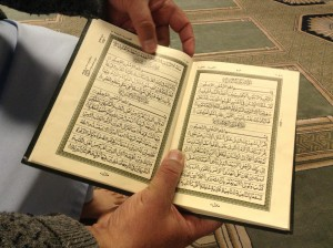 Tahera Qutbuddin says mistreatment of women in the Muslim world and elsewhere has not basis in the Quran, shown here in its original Arabic. Photo by Lucy Schouten.
