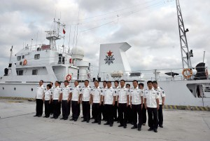In this photo released by China's Xinhua News Ahency, crew members of a fishery administration ship prepare to conduct patrol missions in waters off the Paracel Islands and Scarborough Shoal in the South China Sea.