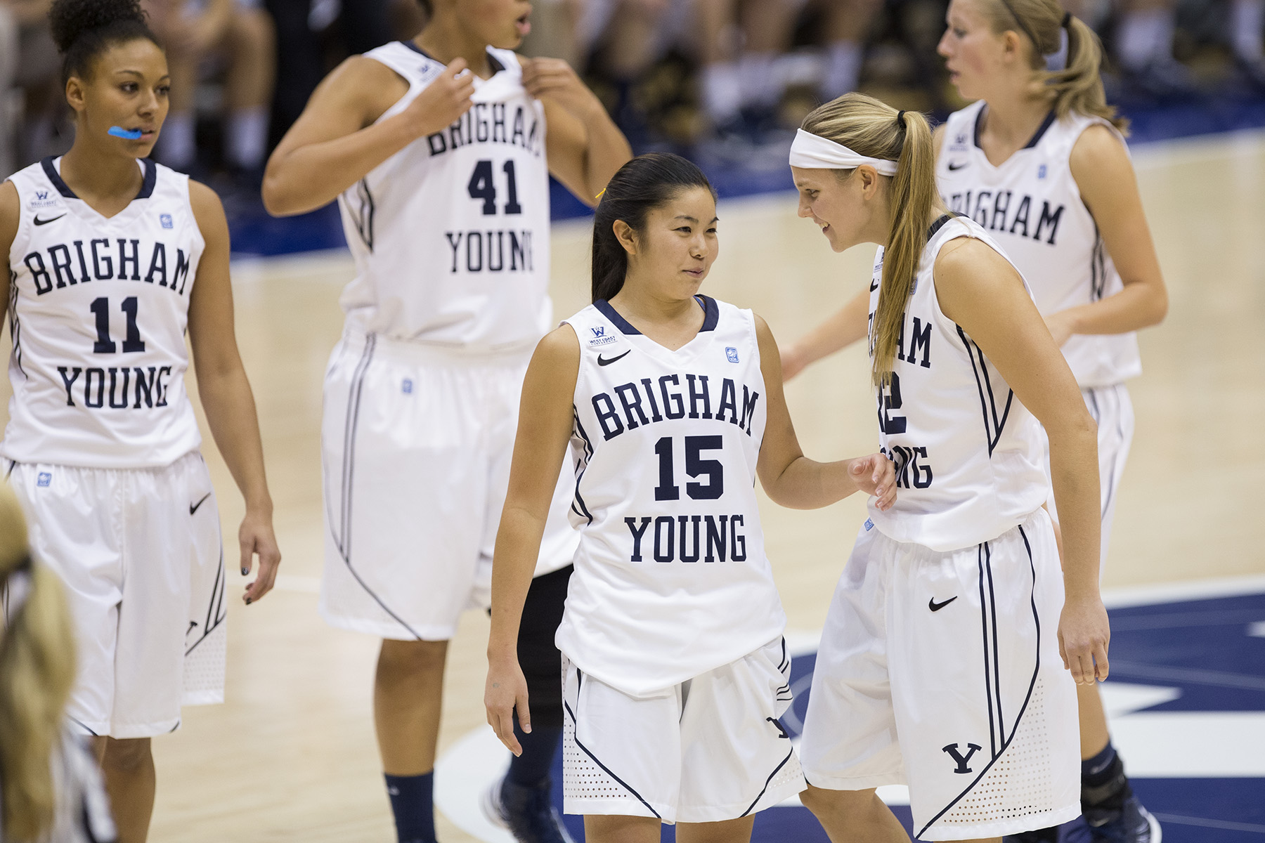The BYU women's basketball team comes together after a play in the first exhibition game against Chadron State. (Photo courtesy BYU Photo)