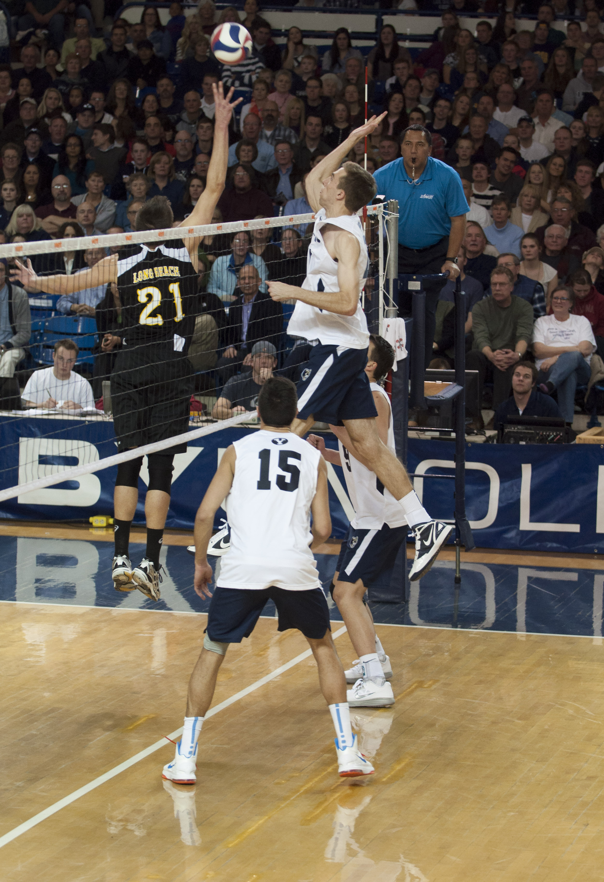 Devin Young goes for a kill in a home game earlier this season. (Photo by Whitnie Soelberg)