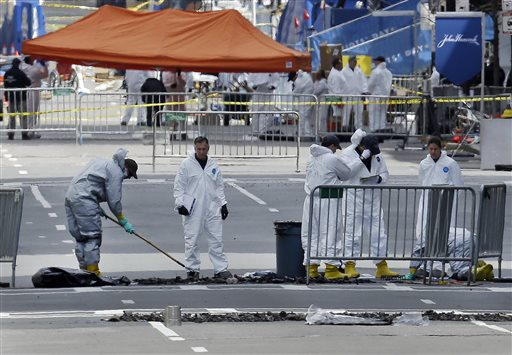 The Boston Bomb Squad examines material after explosions went off at the finish line of the Boston Marathon. (AP Photo)