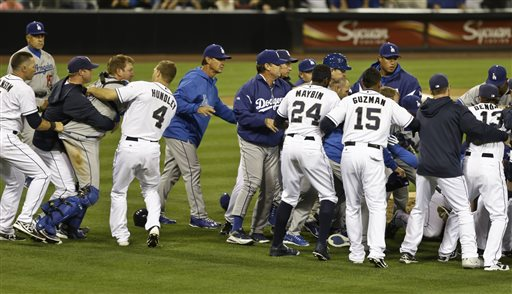 Padres Outfielder Carlos Quinton charges Dodgers Pitcher Zack Greinke resulting in a benches clearing brawl (AP Photo)