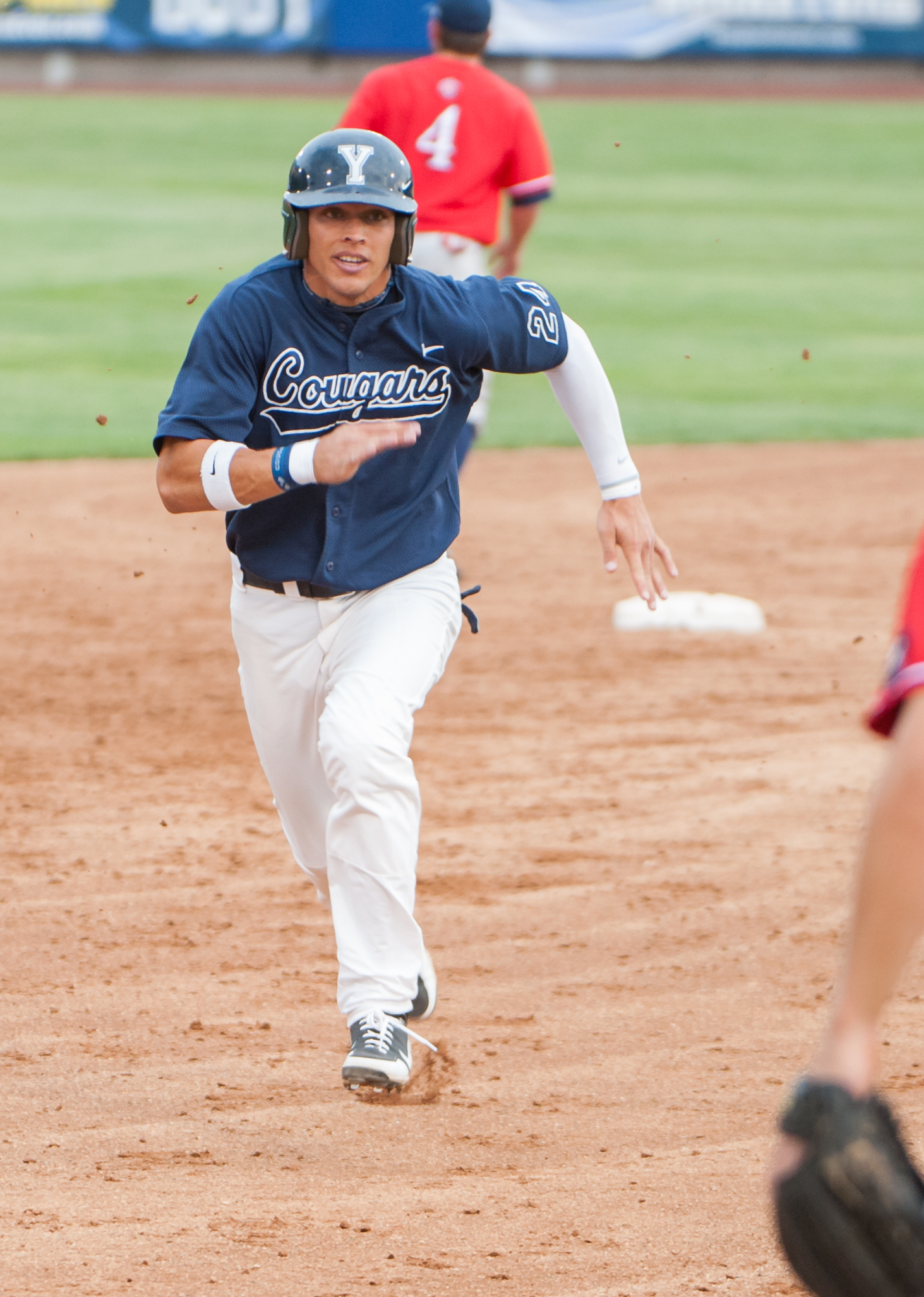 BYU outfielder Jacob Hanneman runs to third base in a game against Gonzaga. (Photo by Elliot Miller)