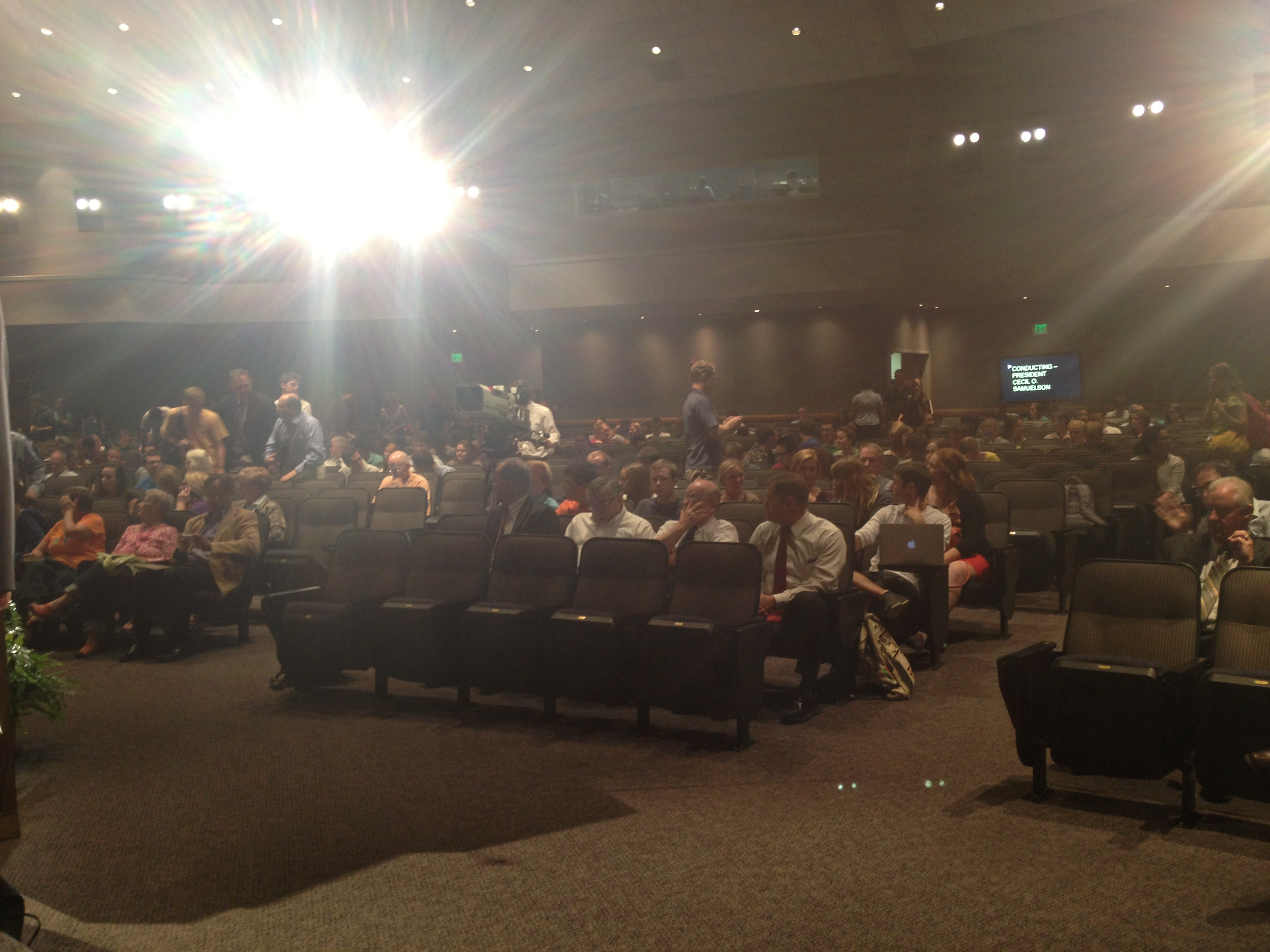 Lights shine and teleprompters roll as the Devotional begins. (Photo by Trevor Carver)