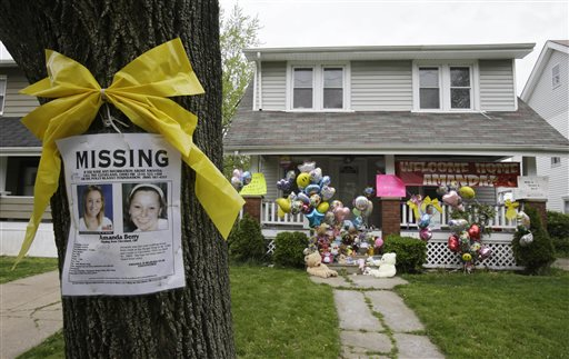 A missing poster still rests on a tree outside the home of Amanda Berry Wednesday, May 8, 2013, in Cleveland. (AP Photo)