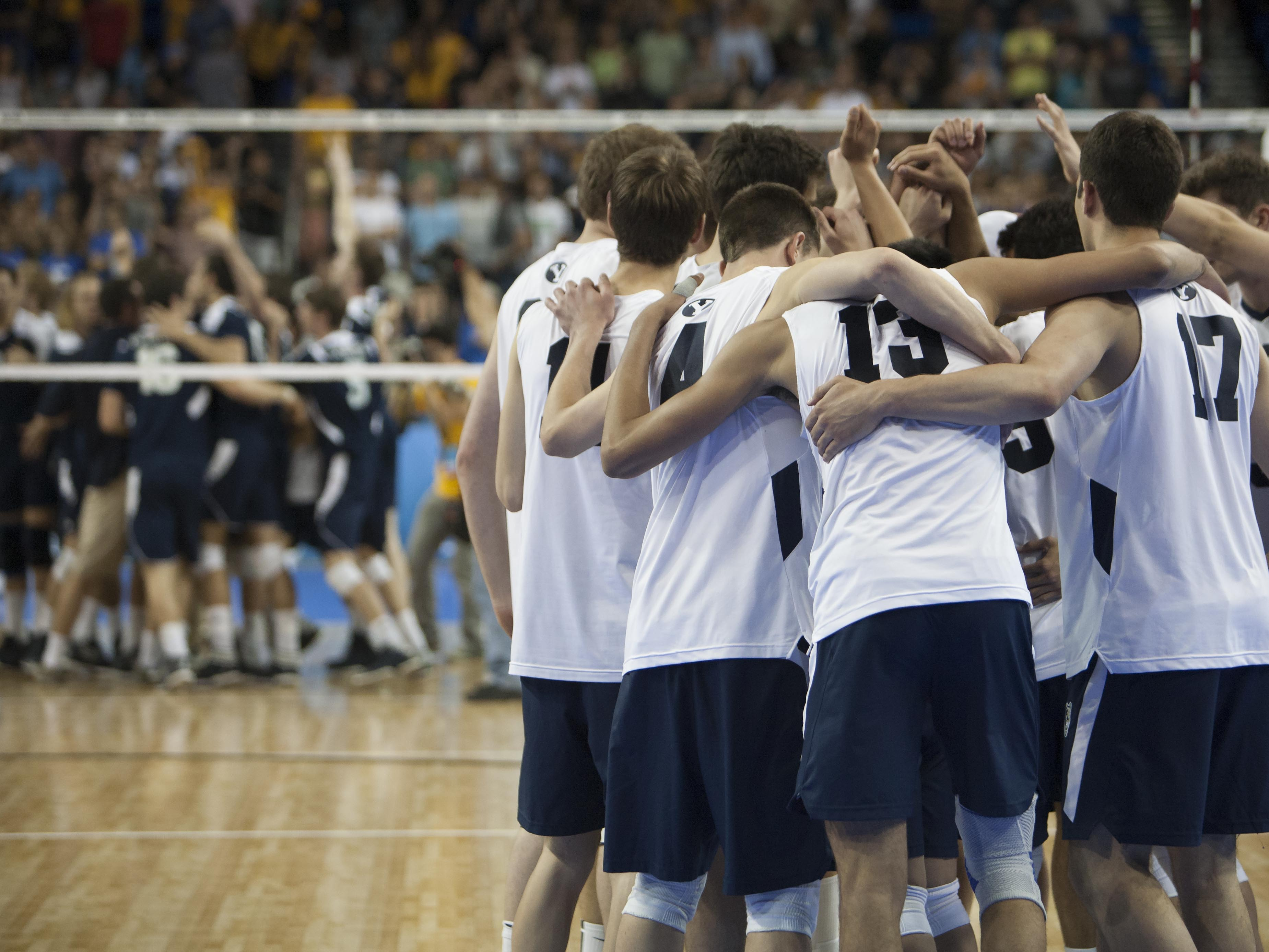 BYU's Men's Volleyball Team huddles together as UCI celebrates their national championship.