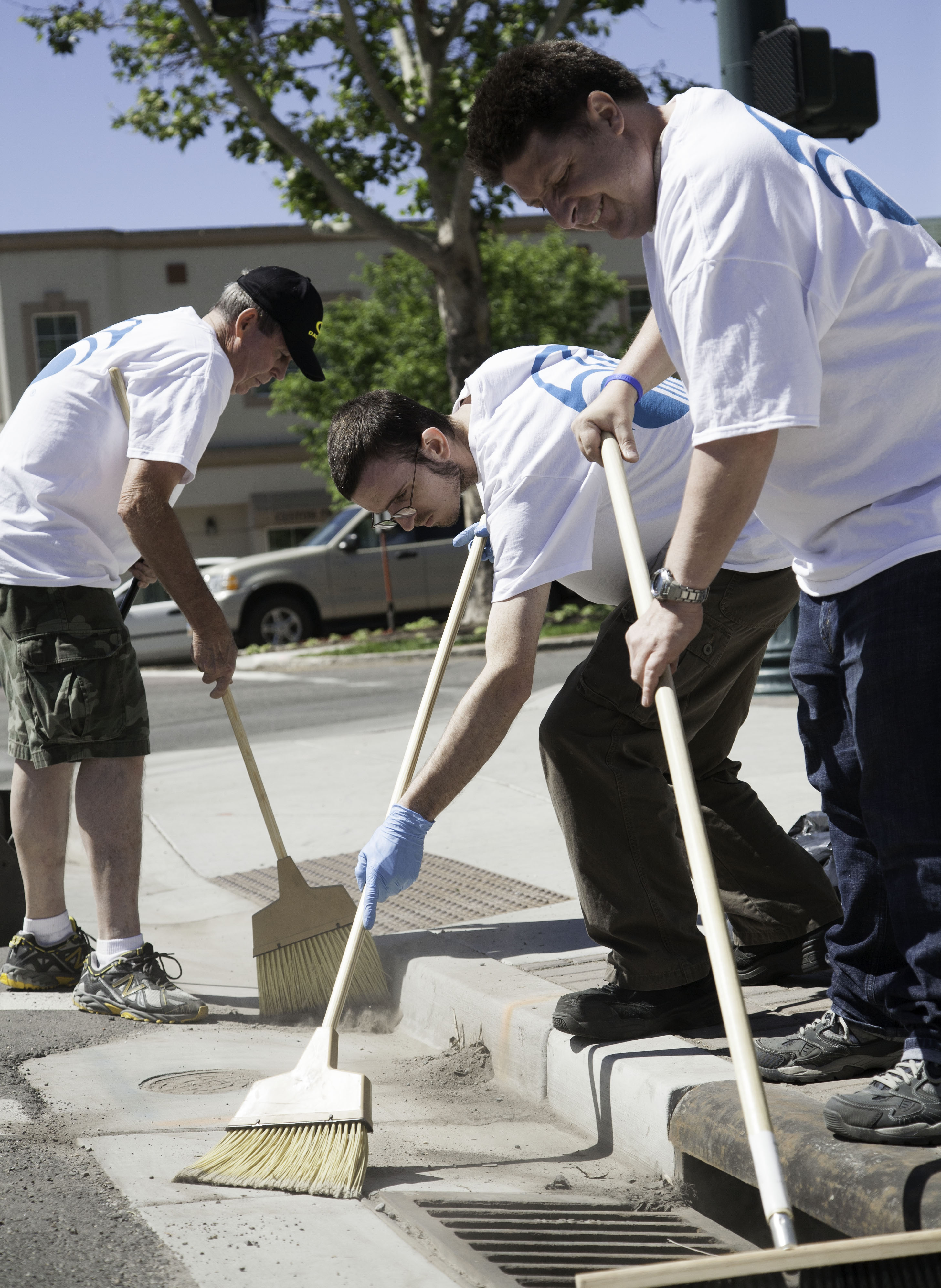 Merrill Steel, James Raddatz, and Kin Nelson help clean up Center Street in Provo as part of Nu Skin's Force for Good Day June 6. Photo by Elliott Miller