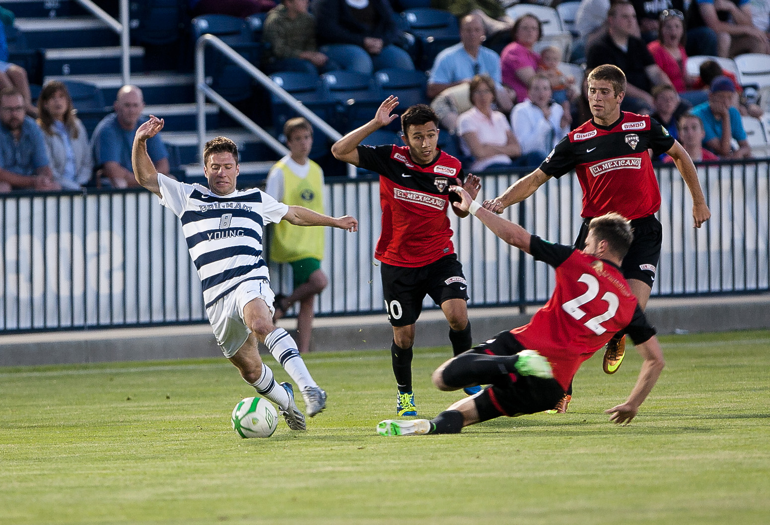 BYU forward Jonathon Junca fights for the ball against a defender during a match against the Fresno Fuego