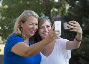 Syd and Brooke Jacques take photos of themselves on their smart phones. According to BYU professors Sarah Coyne and Laura Padilla-Walker, social media provides an opportunity to strengthen parent-teenager relationships. (Photo by Mark A. Philbrick/BYU)