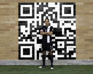 Garrett Gee stands proudly with a QR code, a simple image that led to the development of his popular Scan app. Photo illustration by Elliott Miller