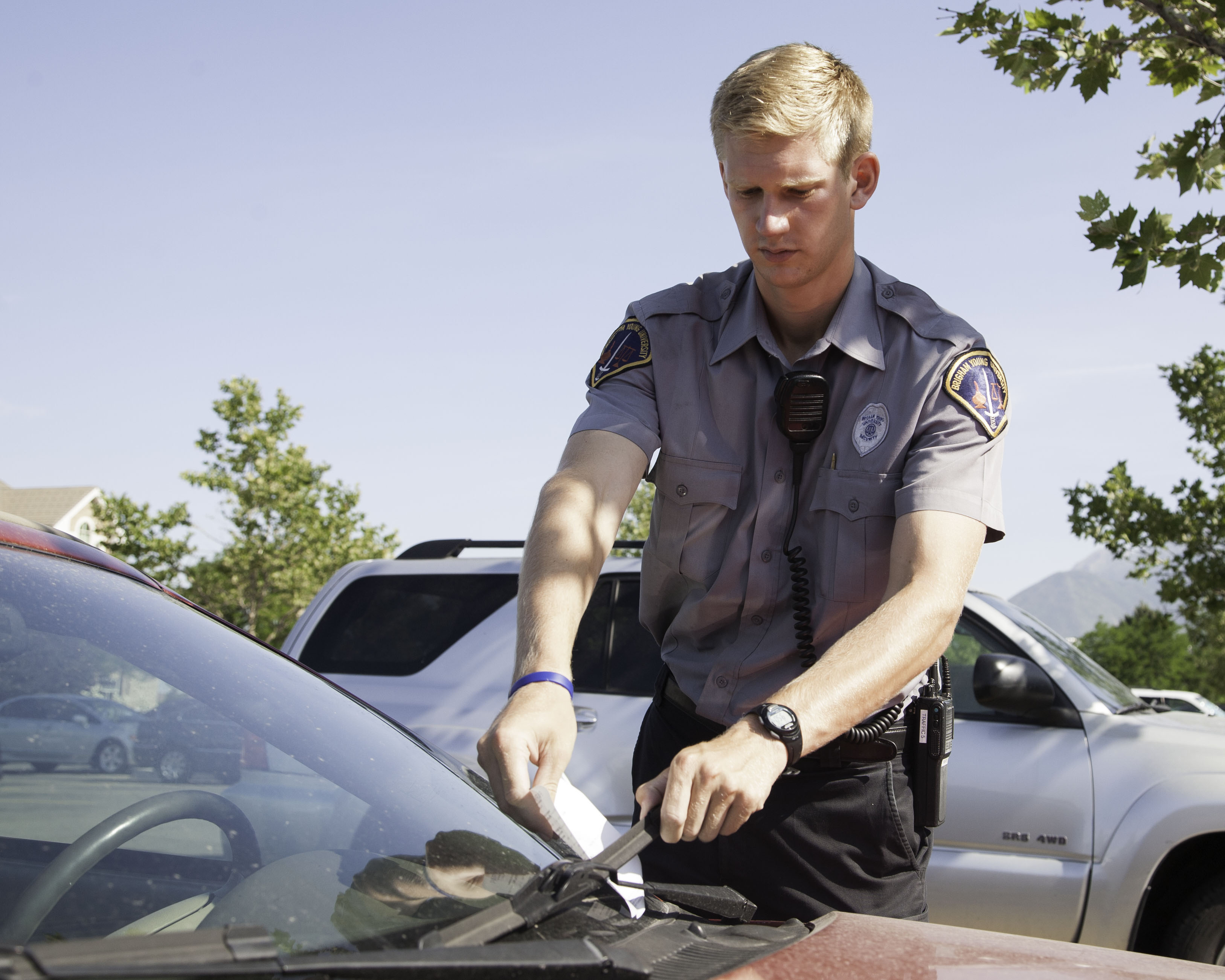 BYU parking police issue tickets to illegally parked cars on campus. (Photo by Elliott Miller)