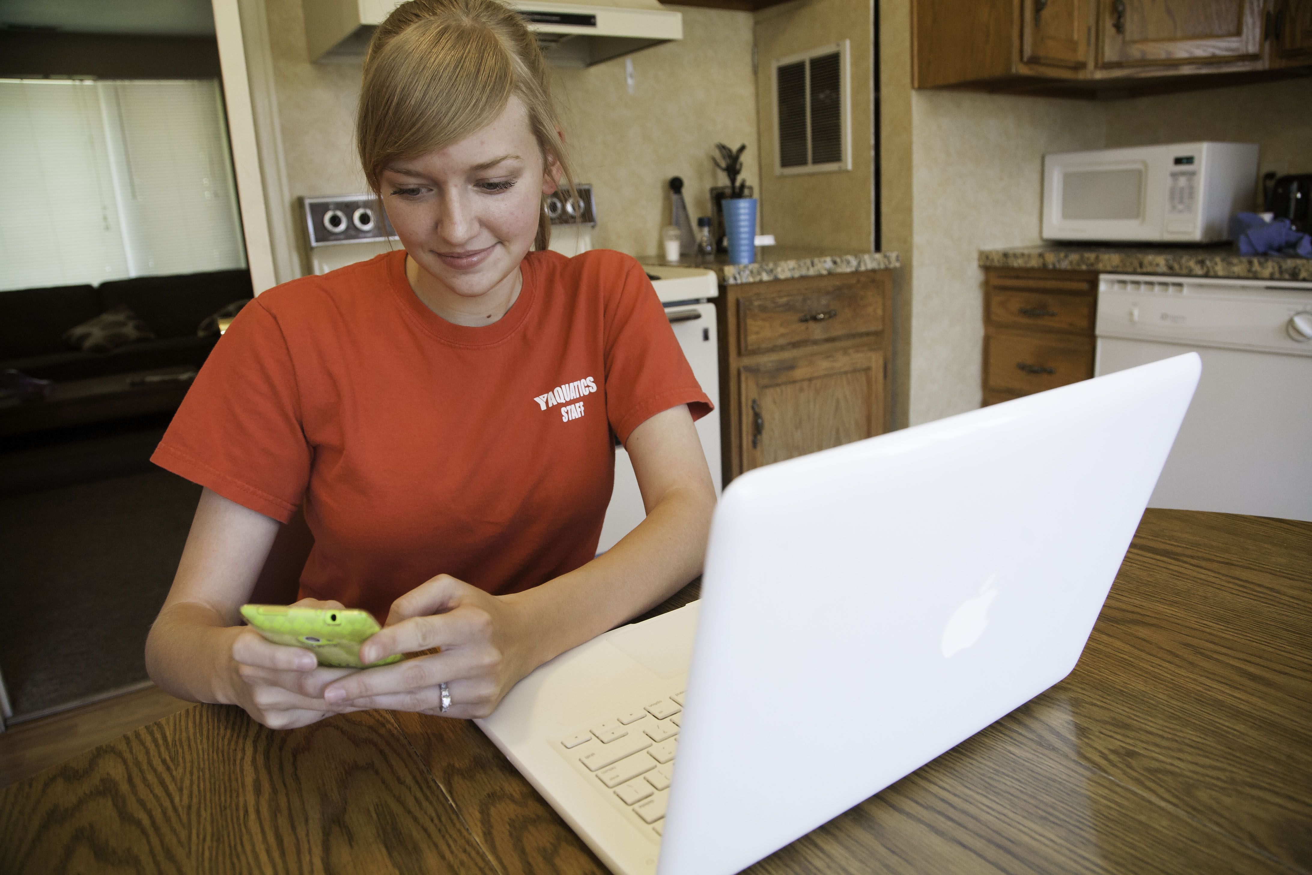 Caitlin Mecham interacts with friends via texting and online messaging.