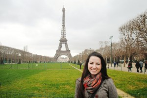 Danielle Cronquist standing in front of the Eiffel Tower during a Winter 2012 study abroad in Paris, France.