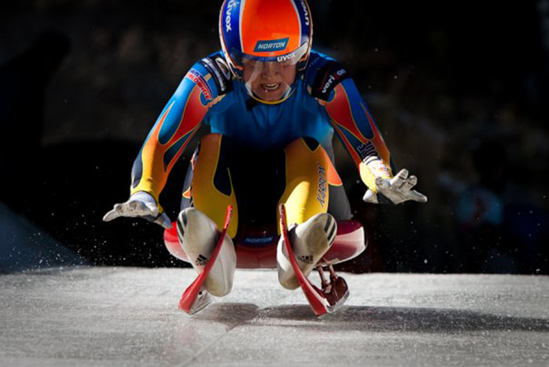 Kate Hansen paddles down the ice during a luge competition. (Photo courtesy Tony Benshoof)