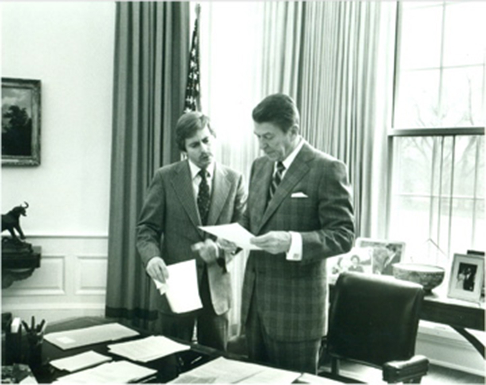 David Fischer, left, speaks with former President Ronald Reagan. Fischer, a member of the law school's 1973 charter class, worked as President Reagan's executive assistant during his presidency.