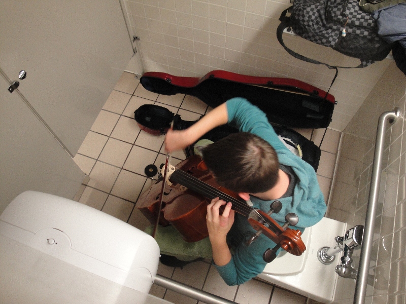 This photo of Alex Lyman practicing his cello in a bathroom in the Wilkinson Student Center was the most popular photo from last year's Day in the Life project.