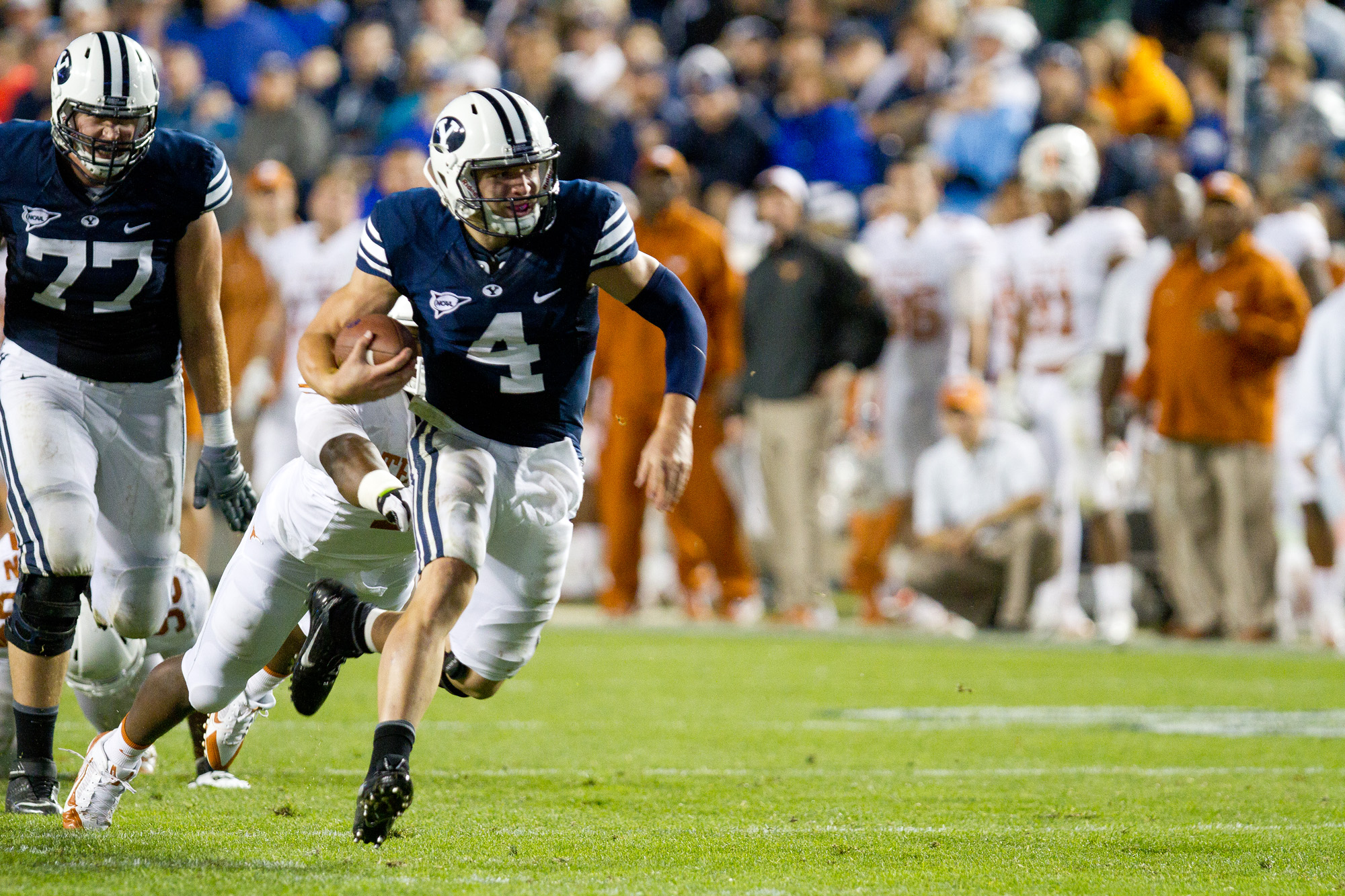 Quarterback Taysom Hill runs the ball during the Sept. 7 game vs. Texas at LaVell Edwards Stadium. (Photo by Sarah Hill.)