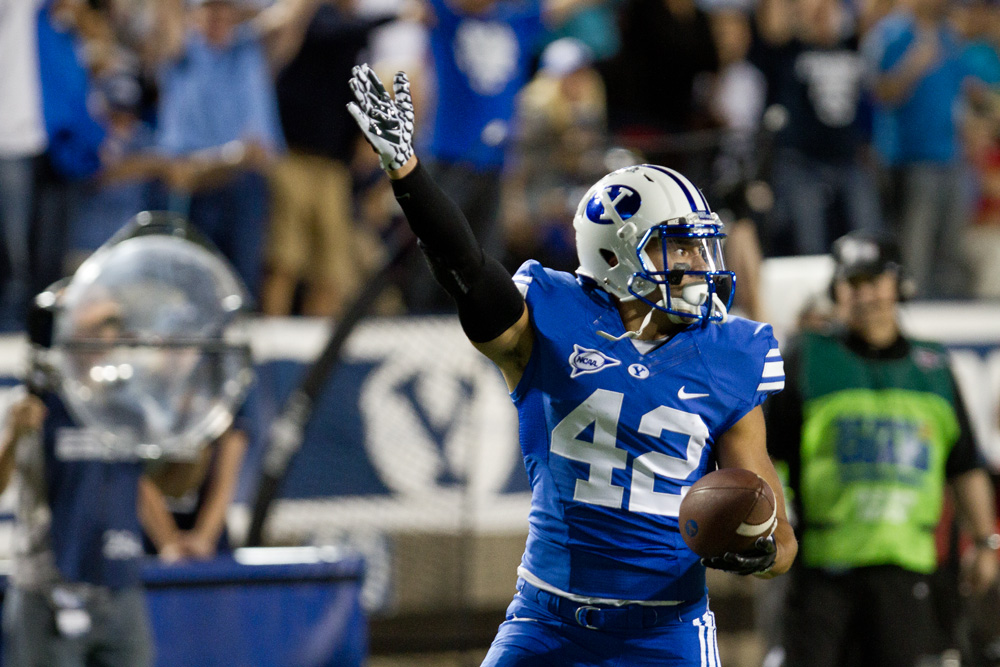 Michael Alisa protests a call during Saturday's game at LaVell Edwards Stadium. The Utes beat the Cougars 20-13.
